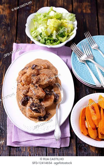 Pork loin with prunes in cream sauce, sweet potatoes