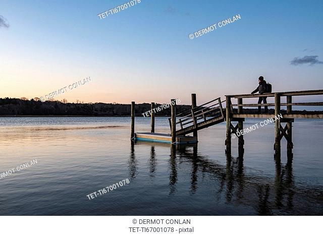 Silhouette of man on pier