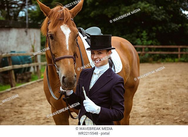 Female jockey leading her horse
