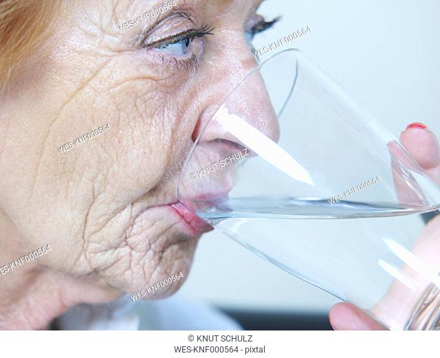 Senior woman drinking water, close up