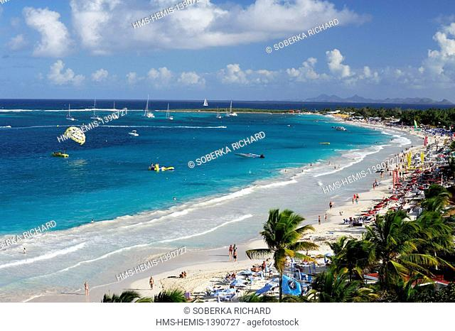 France, French West Indies, Saint Martin, Orient Bay, beach with turquoise waters with Saint Barthelemy on the horizon