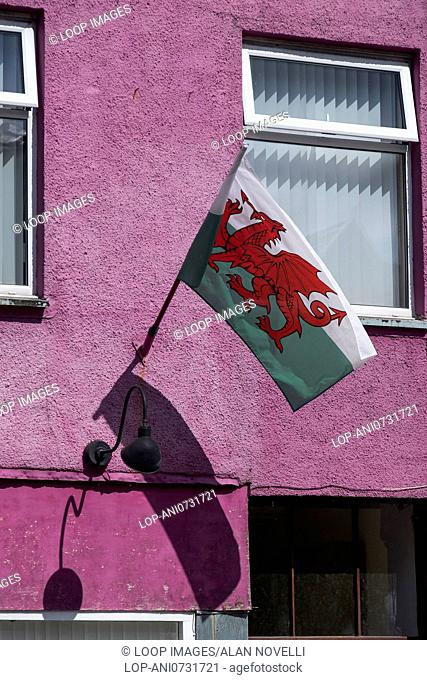 Welsh flag on a colourful building on Llanberis high street in Snowdonia
