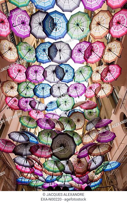 Umbrellas hanging in passage, Bucharest, Romania, Europe