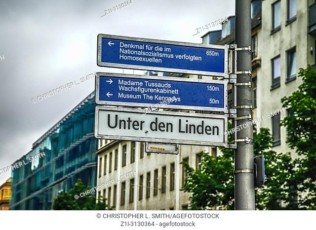 Multiple destinations signpost in Unter den Linden near the Brandenburg gate in Berlin, Germany