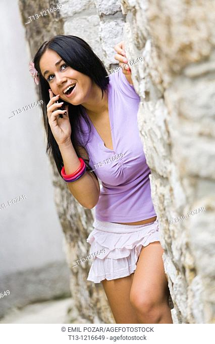 Talking on cellular phone young woman
