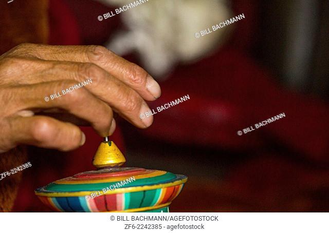 Nepal Himalayas Buddhist nun with prayer beads at the Kharigandentenphelling Monastery in the village of Thamo Solukhumbu Mt Everest remote religion Buddhst...