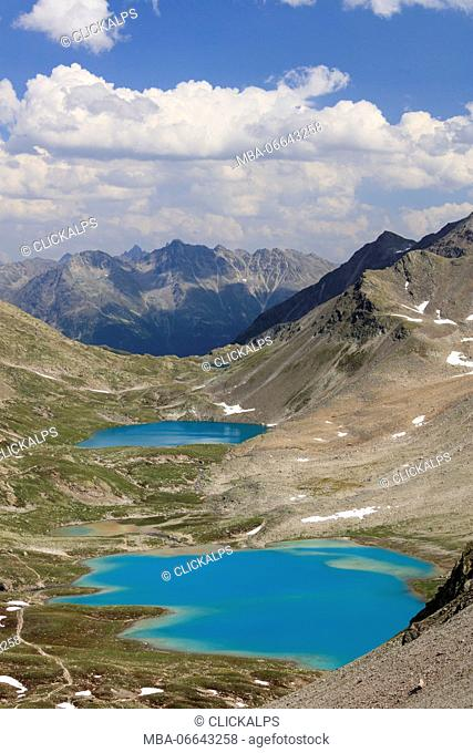 Clouds on the turquoise lakes surrounded by rocky peaks Joriseen Jörifless Pass canton of Graubünden Engadin Switzerland Europe