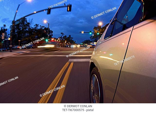 USA, Colorado, Denver, Car on city street at dusk