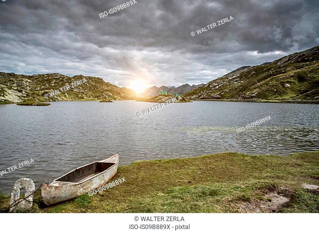 Canoe by lake at sunset, San Bernardino, Ticino, Switzerland, Europe