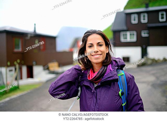 Young woman visiting Trøllanesi, Kalsoy, Faroe Islands