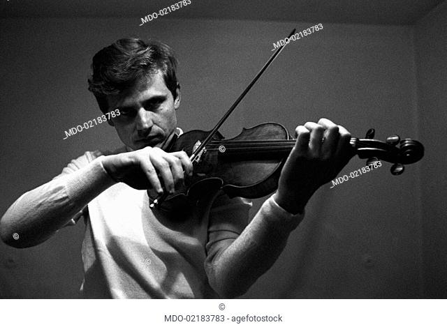 Italian violinist Uto Ughi (Diodato Emilio Ughi) playing the violin. Val Badia, January 1970