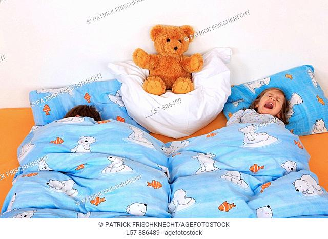little boy and girl in bed, studio, Oetwil am See, Zuerich, Switzerland