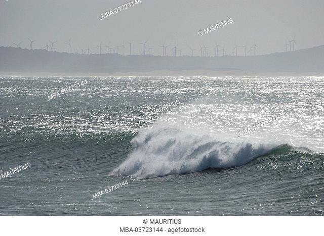 Sea, Atlantic Ocean, waves, wind turbines in the background, Coast close Essaouira (city), Atlantic coast, Morocco
