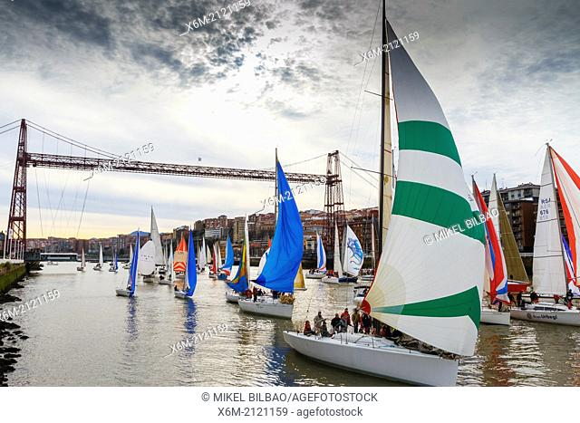 Gallo boat race and Vizcaya bridge. Mouth of Nervion river. Portugalete, Biscay, Basque Country, Spain, Europe