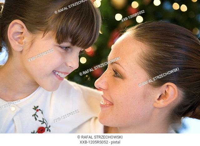 christmas portrait of mum and daughter