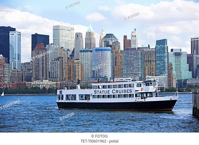 USA, New York State, New York City, Cruise ship on Hudson River, Battery Park in background