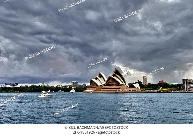 Beautiful downtown Sydney Australia with Opera House with clouds at twilight office skyline in New South Wales
