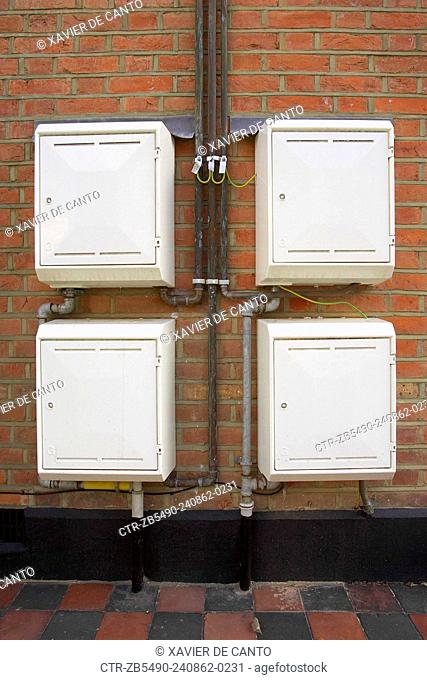 Four gas meter cupboards outside a private house