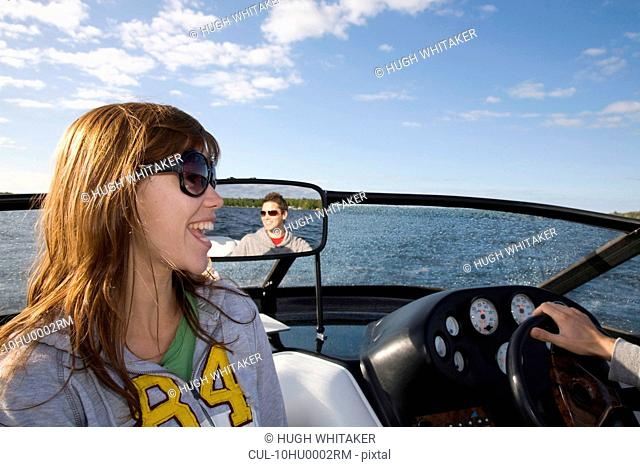 Couple laughing in speedboat