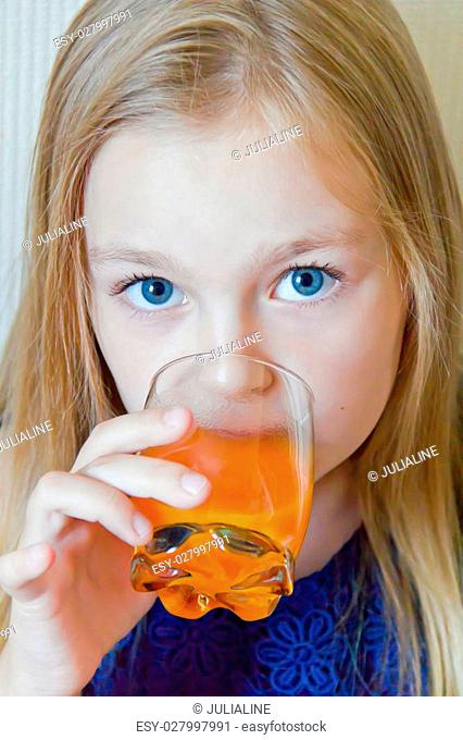 Cute girl with blond long hair drinking beverage