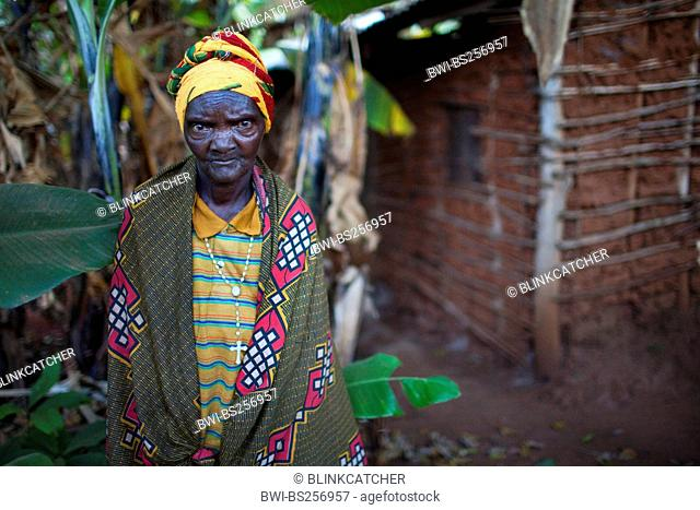 old woman in front of her house in rural area, banana plants in the background, Burundi, Karuzi, Buhiga