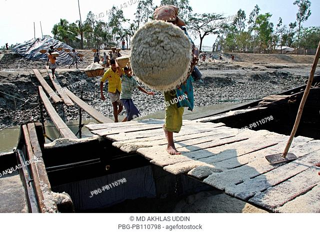 Labourers unload salt at boat that collect from a field at Bashkhali It is one of the oldest and most ubiquitous of food seasonings and used to preserve food...