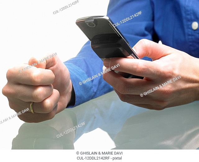 Hands of a woman, holding cellular phone