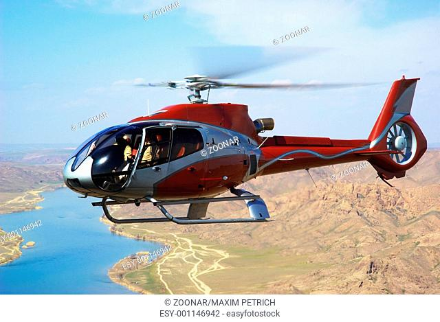 Helicopter on river in desert