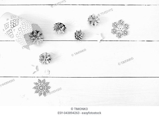Christmas mockup on a white wooden background with snowflakes, a deer and a cone. Flat lay, top view