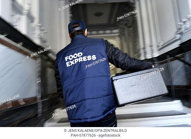 ILLUSTRATION - A driver of the independent delivery service 'Food express' delivers food in Berlin, Germany, 17 April 2015