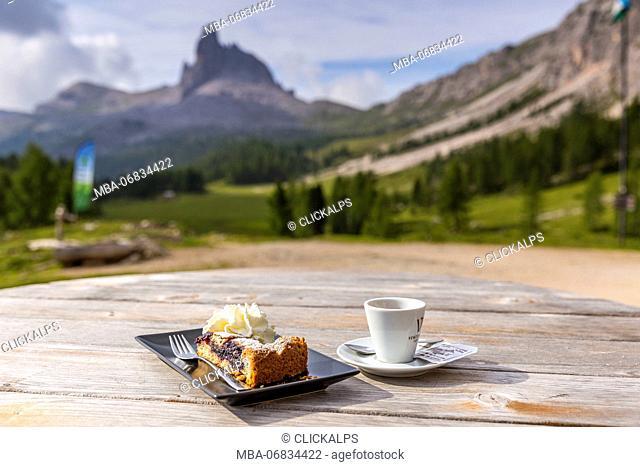 Breakfast at Croda da Lago Refuge with Mount Becco di Mezzodì in the background, Cortina d'Ampezzo, Belluno district, Veneto, Italy