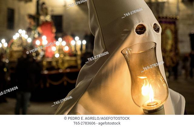 Lugo, a person with robe and hood (cornet processions of Holy Week), carries a candle during the Procession of Bom Jesus and the Nazarene