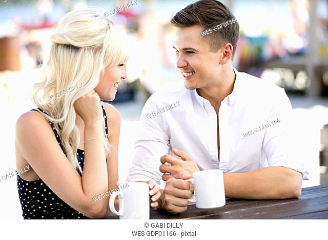 Couple sitting together at outdoor cafe