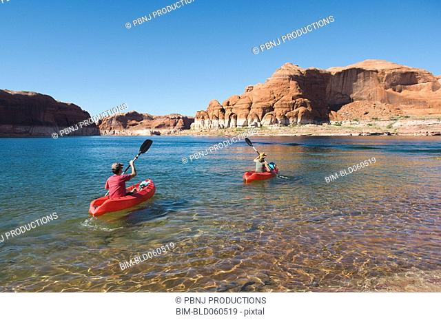 People kayaking in lake