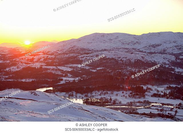 Lake Windermere from Wansfell at dusk in the Lake District covered in snow, UK