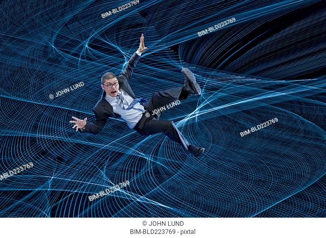 Mixed Race businessman floating in cyberspace