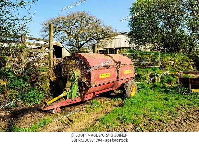 A muck spreader at a farm in Dartmoor National Park