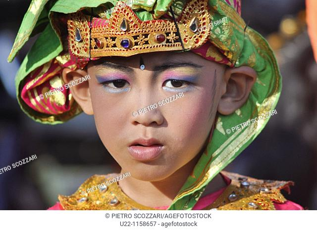 Ubud (Bali, Indonesia): a boy dressed up in traditional Balinese clothes for a children show