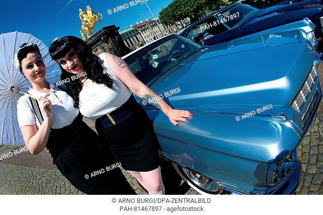 Pin-up models Sandra (L)and Elisa pose next to a Cadillac (series 62) during a photocall for the USCar Convention, inDresden, Germany, 23 June 2016