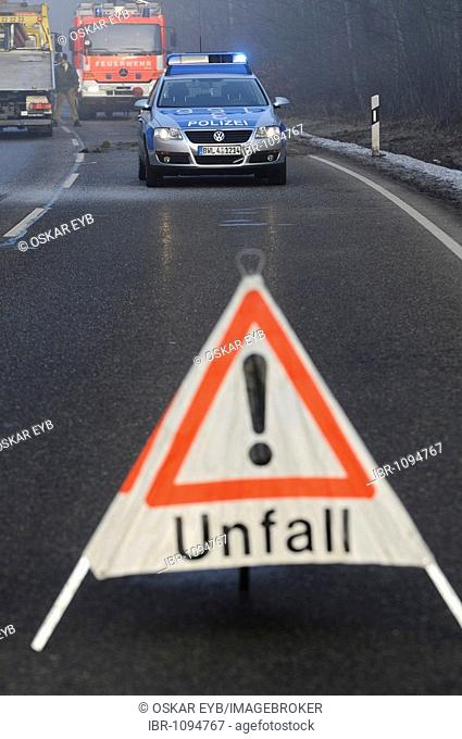 Police car and warning sign, securing the accident scene after a severe traffic accident on L 1150, Esslingen, Baden-Wuerttemberg, Germany, Europe
