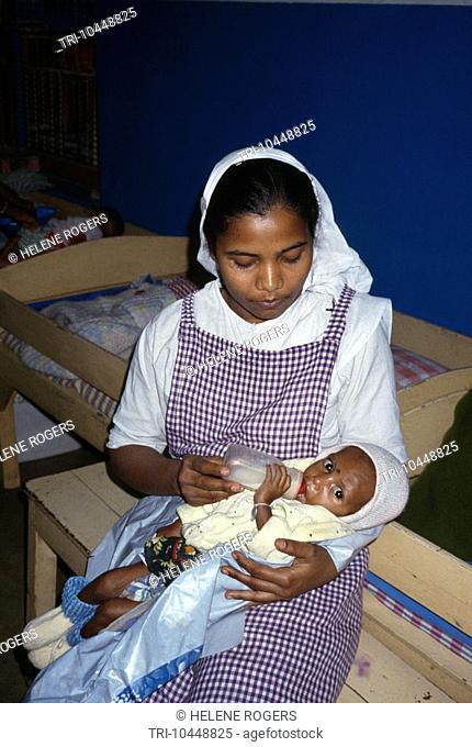 Calcutta India Marasmus Mother Theresas Childrens Home Nurse Undernourished Baby 18 Months Bottle Feeding