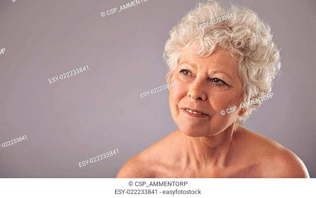 Attractive senior woman daydreaming