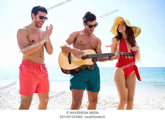 Cheerful young friends enjoying at beach