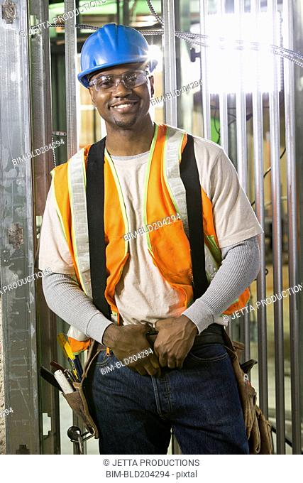 African-American worker smiling on site