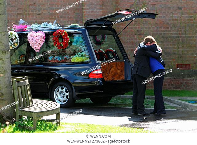 A distraught Ian Beale leves the church after daughter Lucy's funeral to be consoled by ex-wife Jane Featuring: Adam Woodyatt,Laurie Brett Where: London