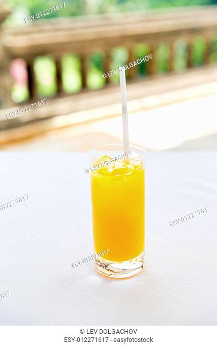 drinks and food concept - glass of fresh orange fruit juice at restaurant