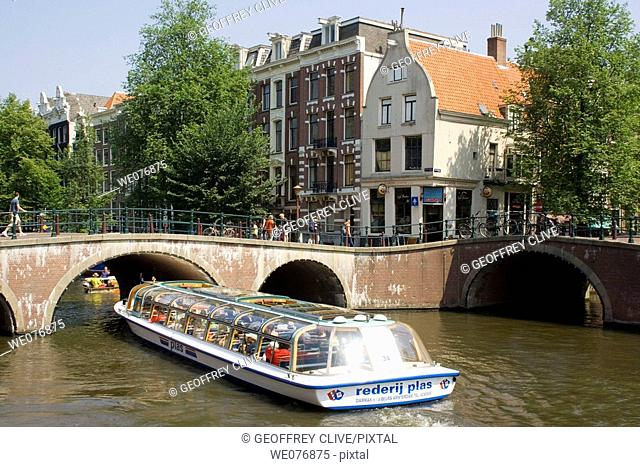 Tour boat on canal, Amsterdam. Holland