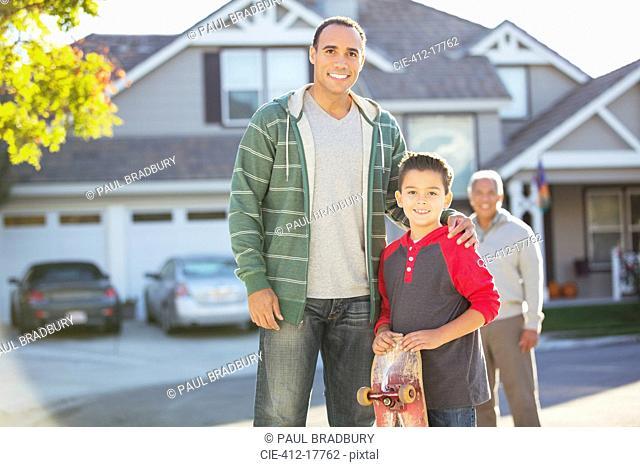 Portrait of multi-generation men in driveway