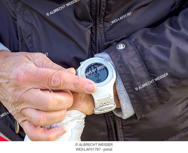 Woman wearing golf watch, close-up