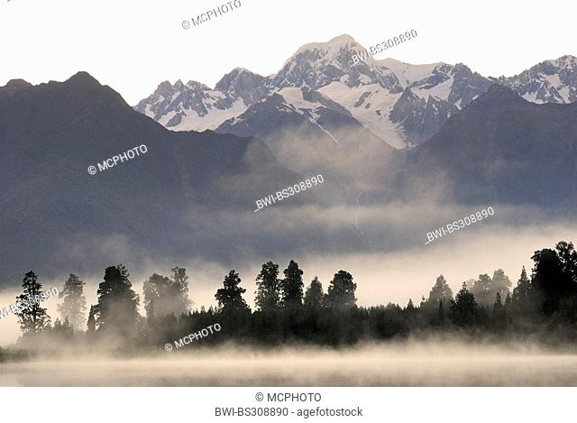 panoramic view from the Lake Matheson with morning mist at Mount Tasman (3498 m), New Zealand, Southern Island, Westland National Park